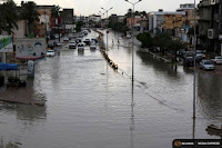 A flooded street is pictured after heavy rains caused the closure of several main streets in Libya's capital Tripoli. (Credit: Reuters/Hani Amara) Click to Enlarge.