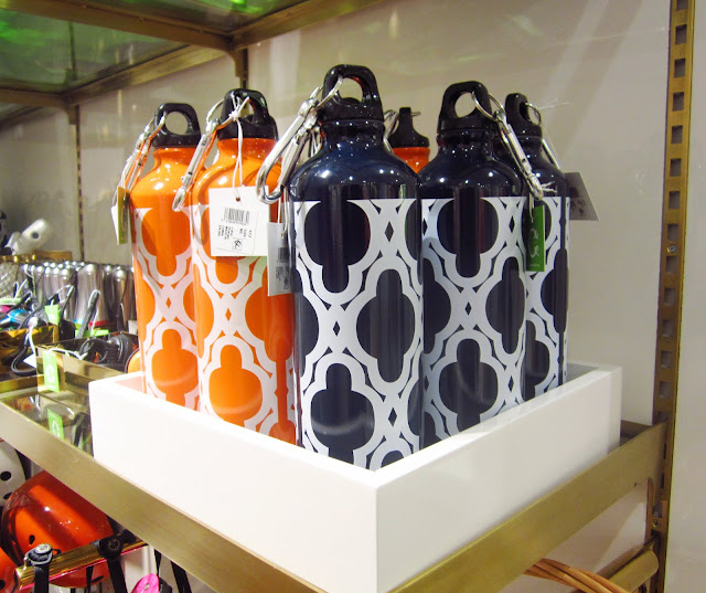 orange and navy metal water bottles in a square white box