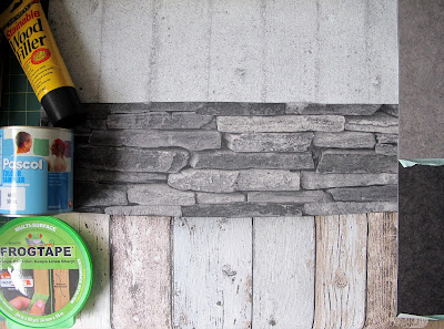 Three wallpaper samples, two vinyl tile samples, a pack of Frogtape, a sample pot of paint and a tube of wood filler.