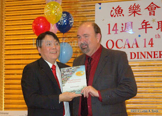 image Raymond Zee, OCAA, presents award to Jack Summers Radioworld Canada
