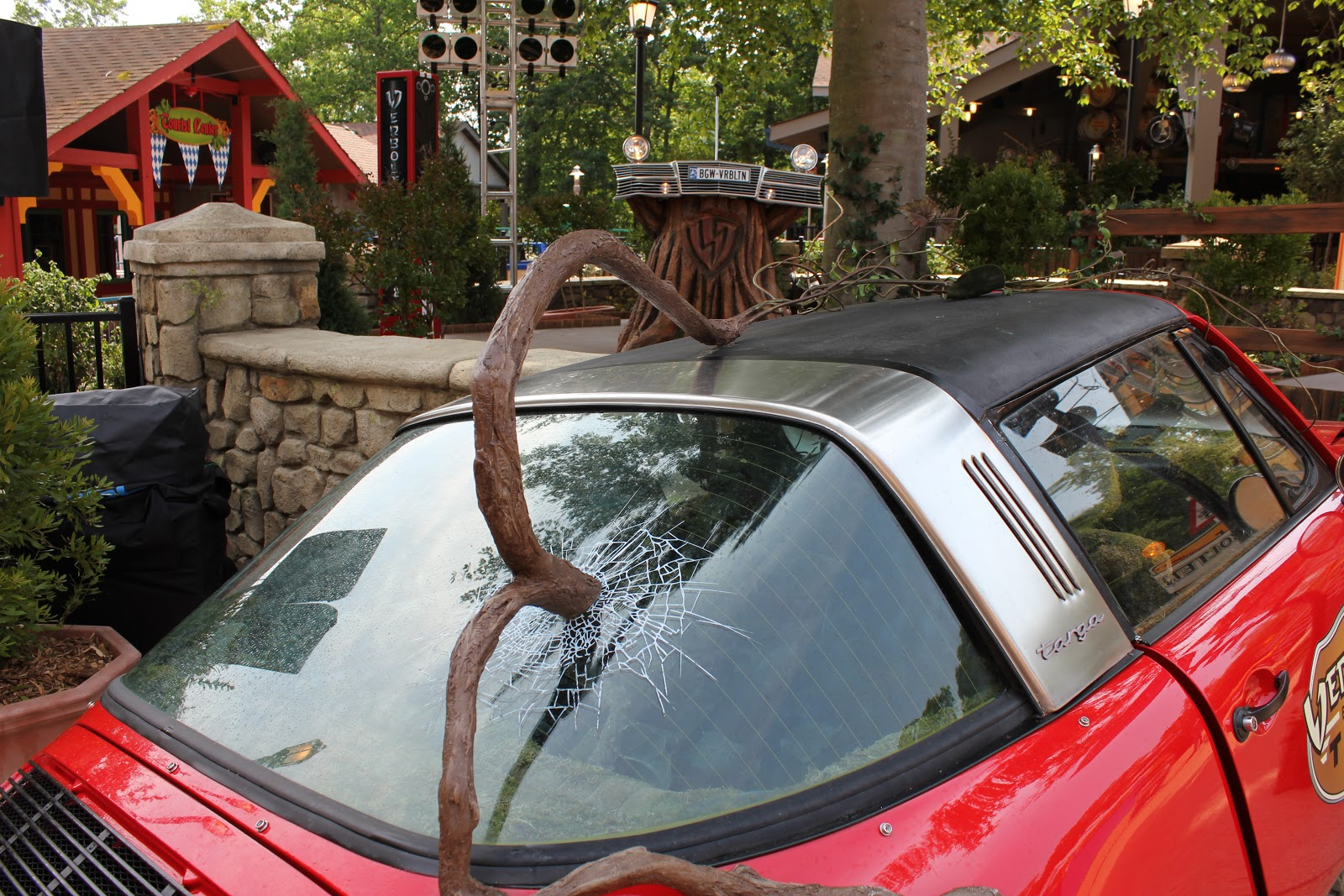 As You Walk Up To The Attraction Immediately Notice A German Targa Automobile That Has Been Severely Damaged By Looks Of Gigantic Vine