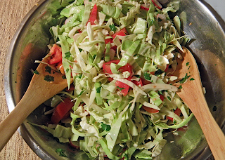 Salad in Serving Bowl with Tongs