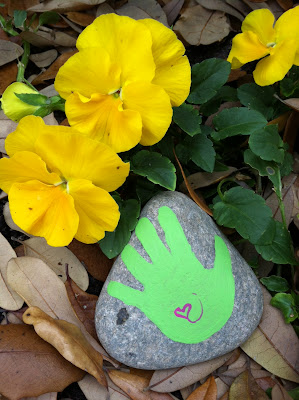 nature inspired green hand painted rock with pink heart