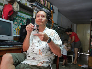 Santiago de Cuba interior Pedro sips a cafecito