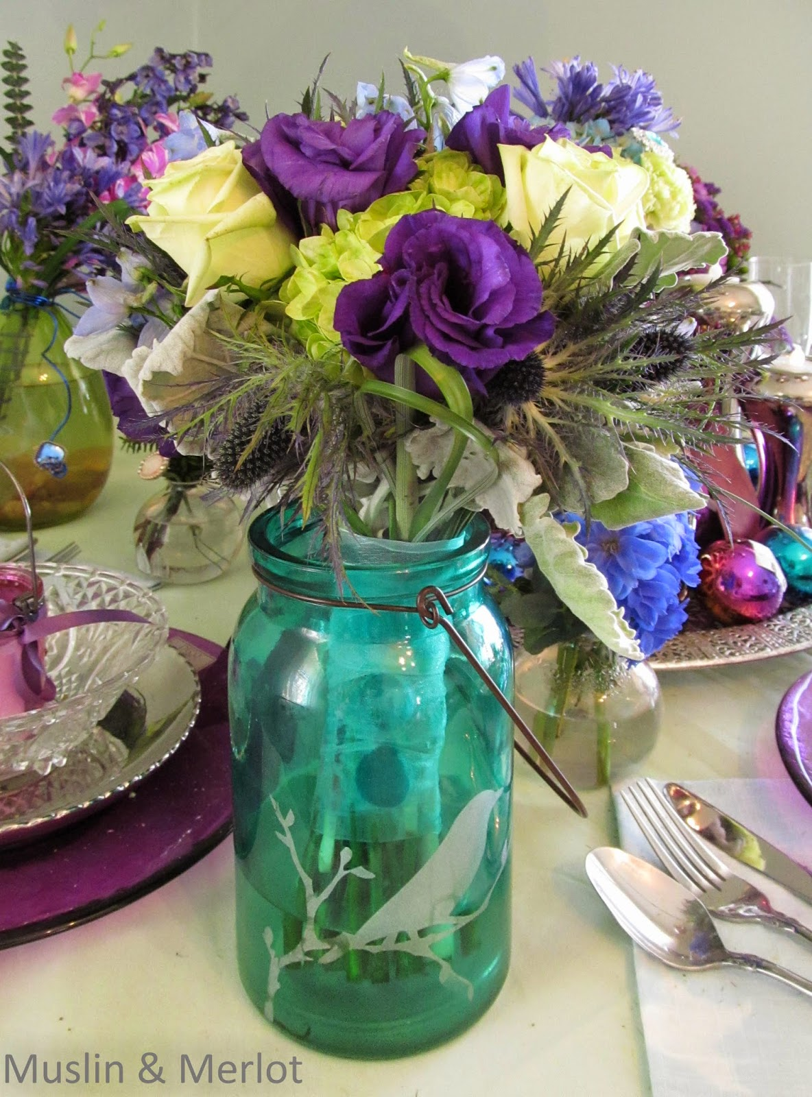 Stems wrapped in ribbon, placed in painted jar. Very pretty.