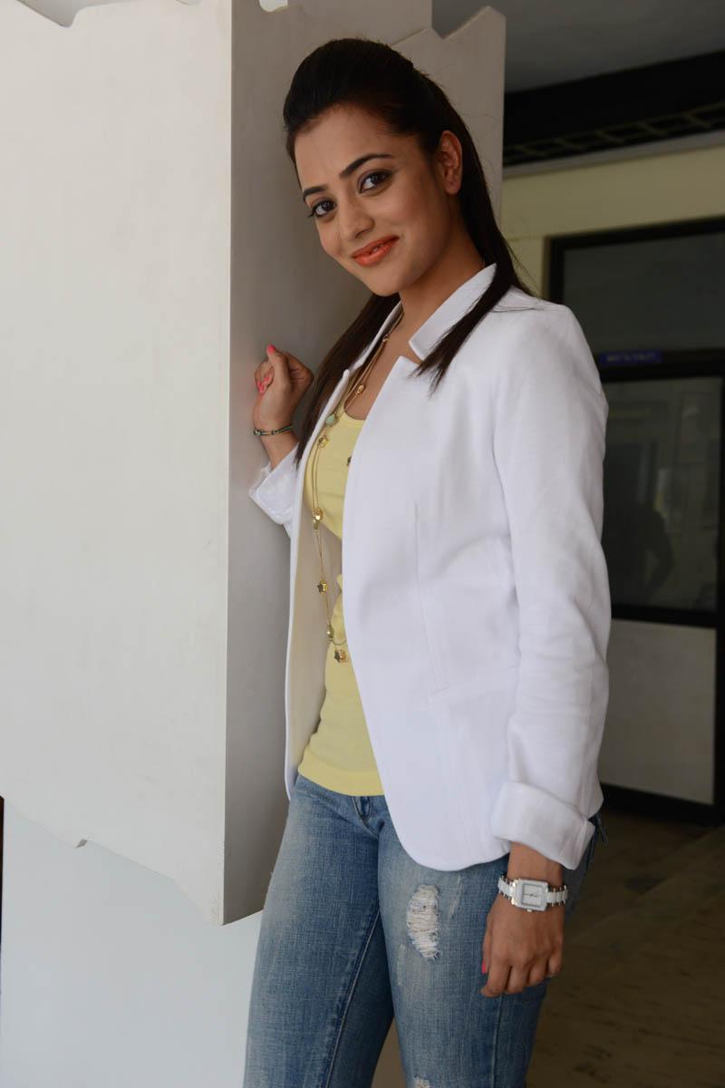 hot deshing sexy stylish Nisha agarwal latest photos in white coat at sukumarudu pm