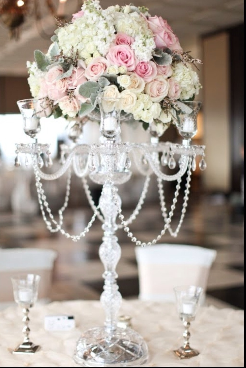 The rose colored aisle candelabra centerpieces