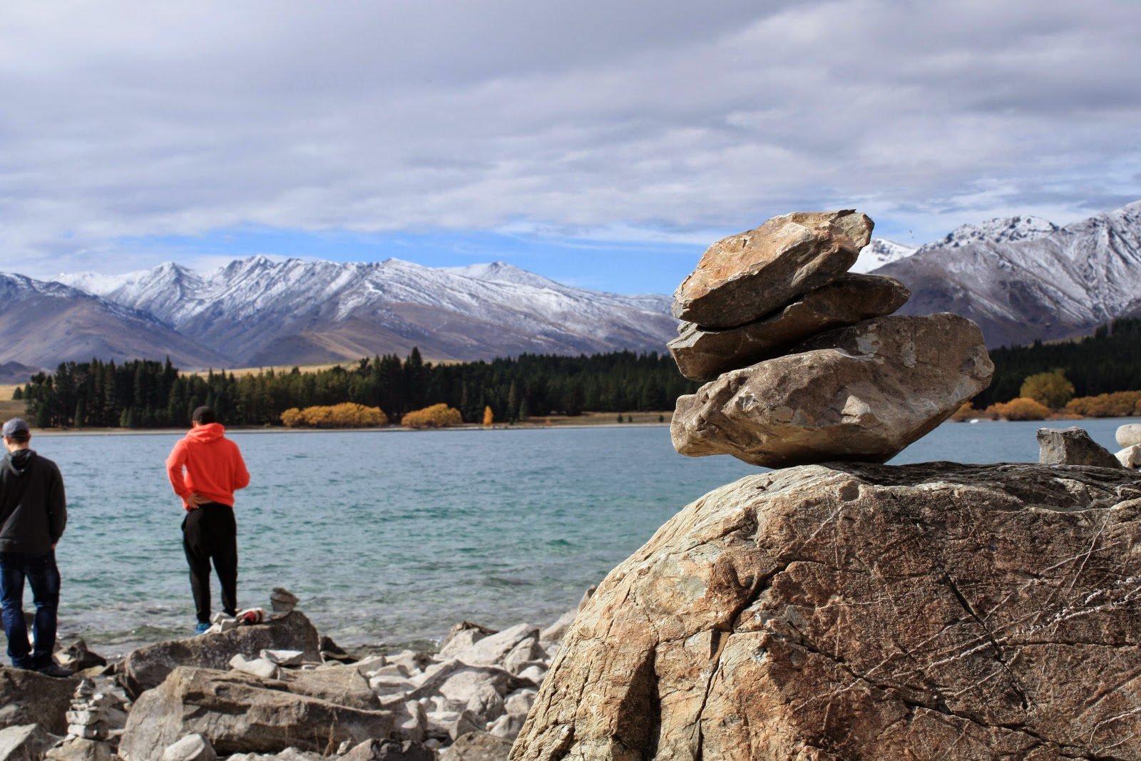 A pile of stacked stones by Lake Tekapo, in the South Island of New Zealand.