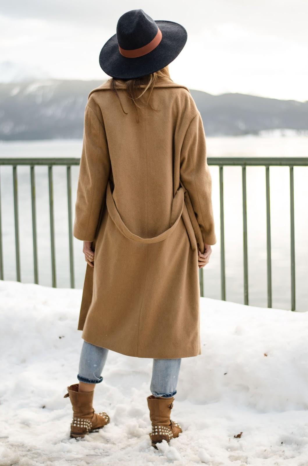 kristjaana mere camel coat boyfriend jeans ankle boots fedora snow