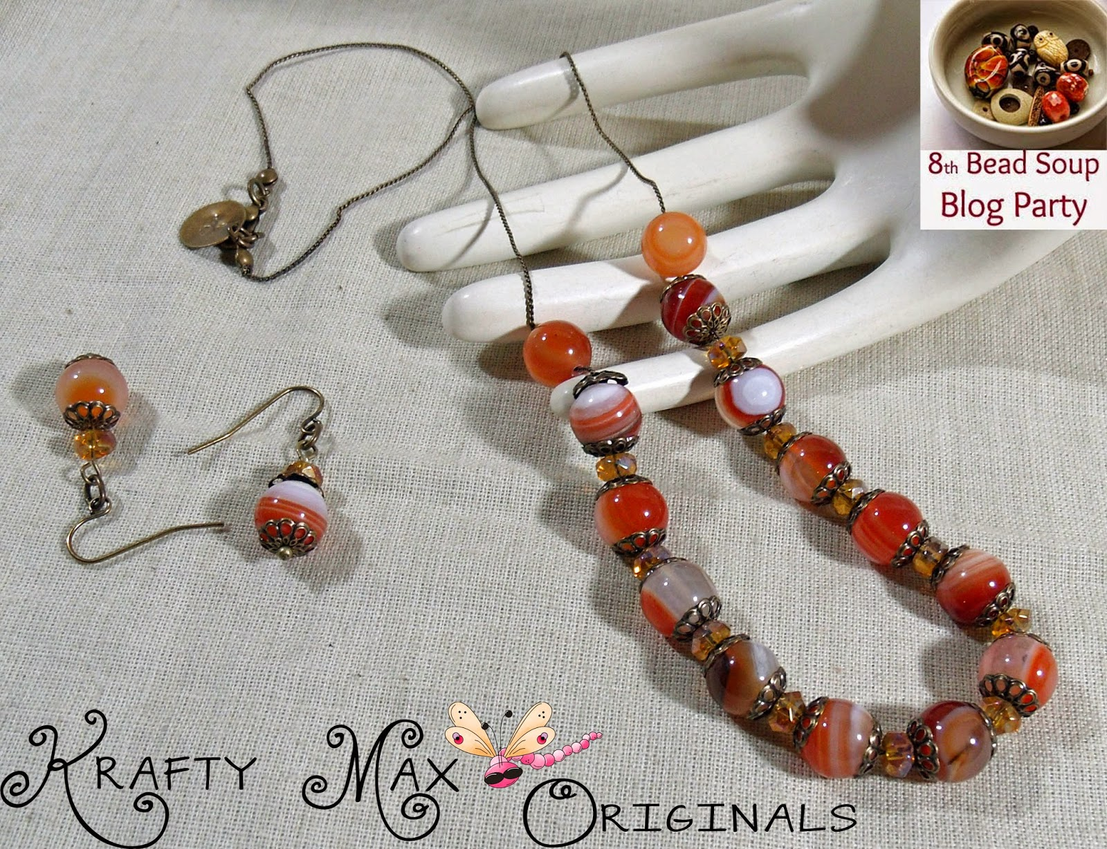 http://www.artfire.com/ext/shop/product_view/KraftyMax/9283209/8th_bead_soup_blog_party_-_glowing_red_agate_neclace_and_earrings/handmade/jewelry/sets/gemstone
