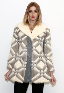 Vintage 1960's brown and cream colored diamond patterned bohemian fur coat.