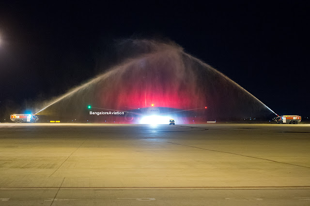 Air India 787 Dreamliner VT-ANH gets water cannon saute by ARFF on its first flight at Bangalore Airport.
