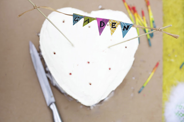 heart-shaped birthday cake with name topper