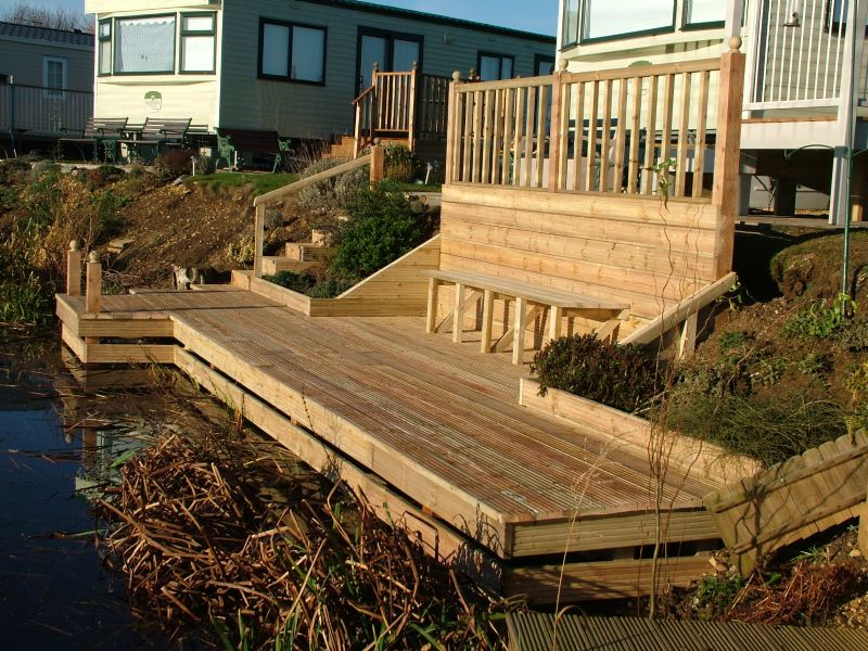 Garden decking ideas and tips garden edging ideas for Images of garden decking