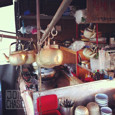 Kettles, pots, and dishes inside a makgeolli truck in South Korea.