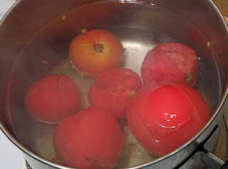 Tomatoes in Boiling Water with Skin Loose