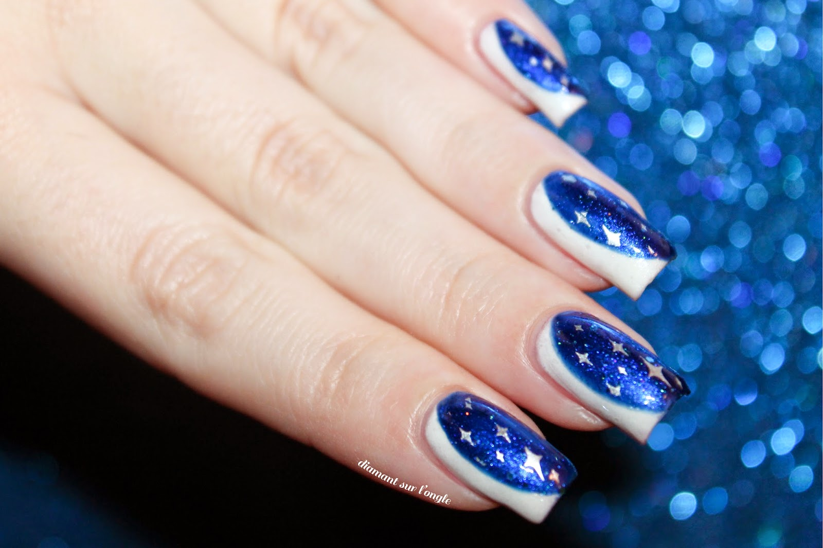side white and blue galaxy french nail art