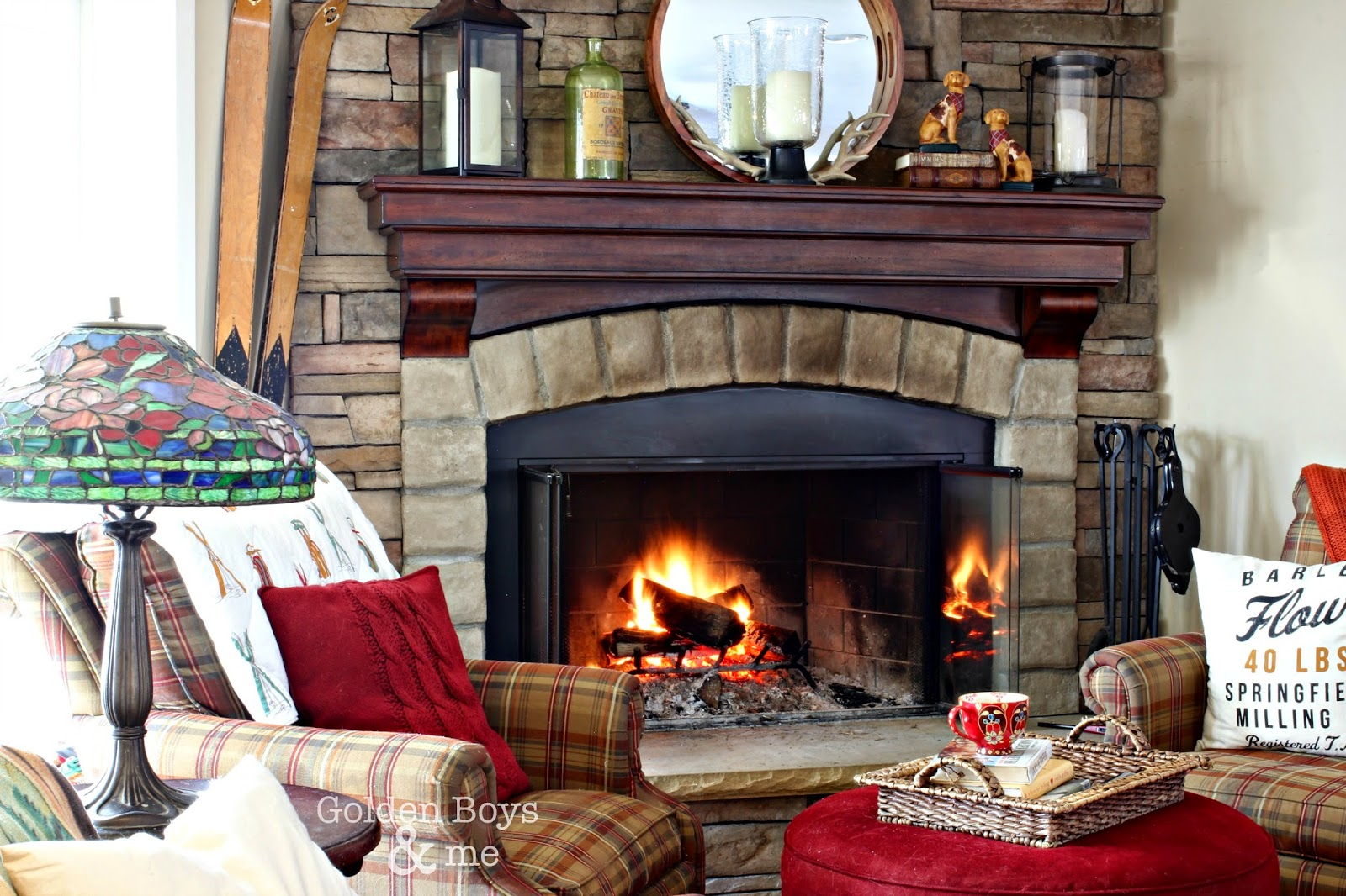 Vintage sled and skis throw from Garnet Hill on plaid chair by stone fireplace-www.goldenboysandme.com