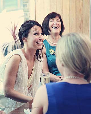 bride and mum laughing at St Chads place wedding