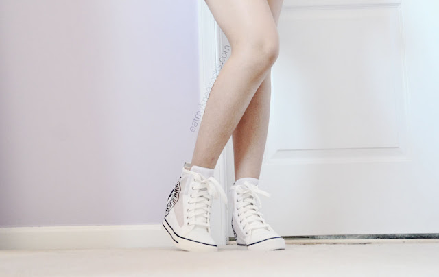 For a cute look that combines simplicity with sportiness, try white mesh sneaker wedges, like these from Milanoo.