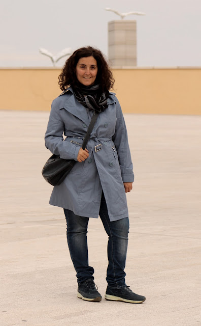 blue trench and coccinelle bag