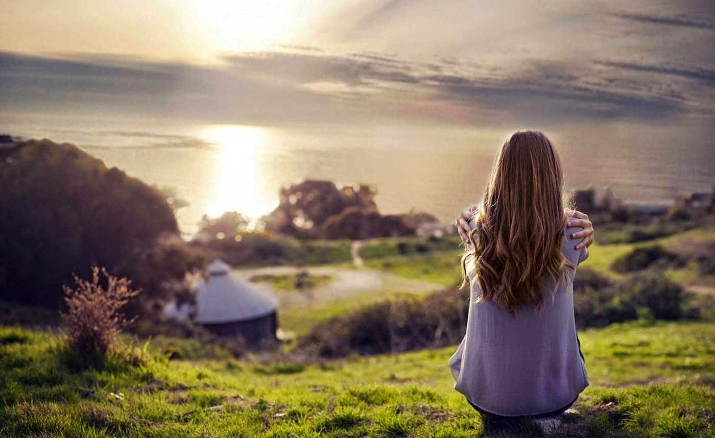 Girl relaxing with nature's beauty image
