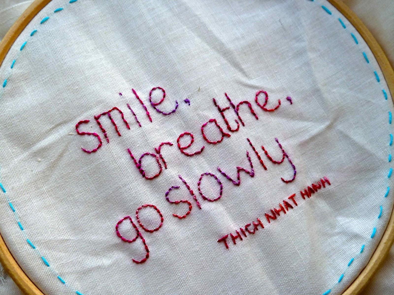 Embroidery of smile, breathe, go slowly on calico