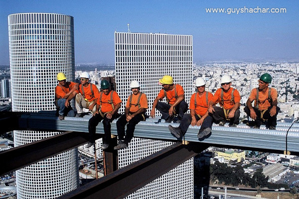 Construction workers on the skyscraper in Tel Aviv