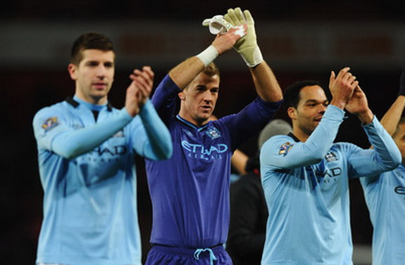 Matija Nastasić, Joe Hart and Joleon Lescott of Manchester City applaud the travelling fans