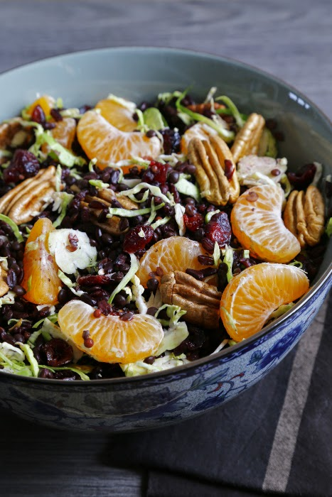 Salad Bowl with a salad of rice, lentils, clementines, cranberries and Brussels sprouts