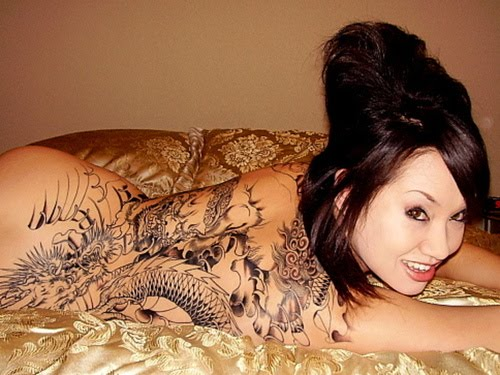 tattoos pictures for women breast.  of women to show their full tattoos. The shape of part of a breast may