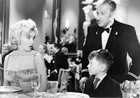"George Winslow, seated, and Marilyn Monroe in the film ""Gentlemen Prefer Blondes."" Credit 20th Century Fox, via Photofest"