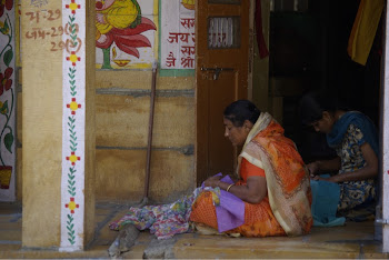 INDIA 2011: Women embroidering sequins on beautiful sari's