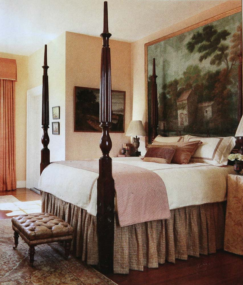 In a guest bedroom Amelia has used a large early 19th century French  gouache which hangs to great effect behind the mahogany four poster bed.