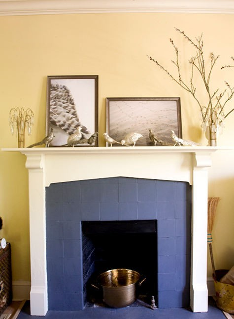 Yellow Painted Brick Fireplace