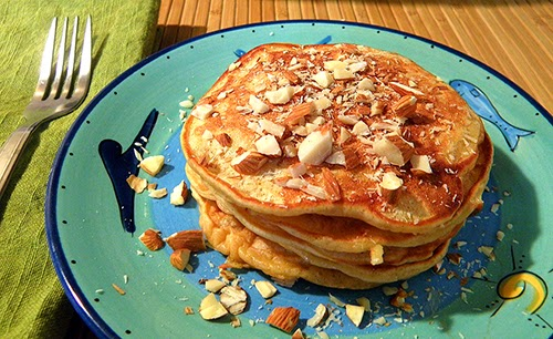 Another view of Pancakes stacked on plate
