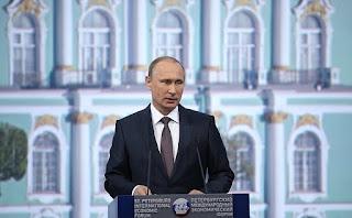 Vladimir Putin, Russia Slighted in World Order, photo of Putin at the St. Petersburg Economoic Forum taken by courtesy of the  Kremlin