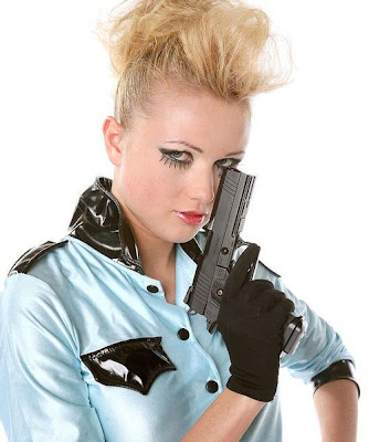 Blonde cop girl with a gun