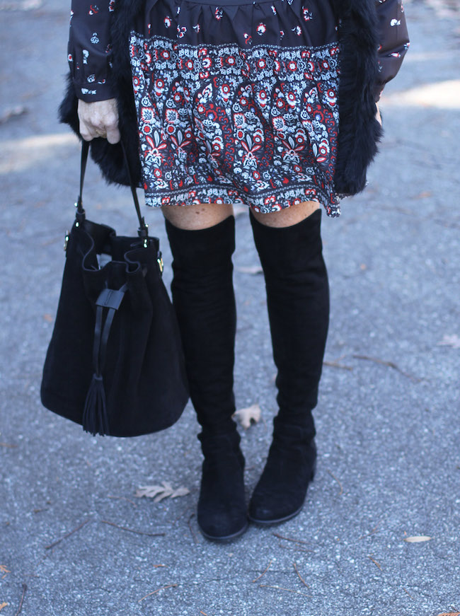 black bucket bag, over the knee boots