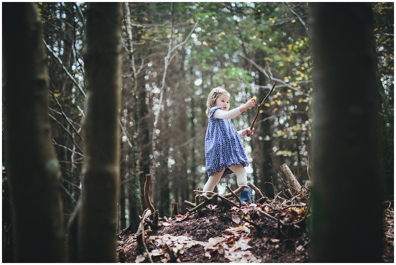 Young girl playing in the forest