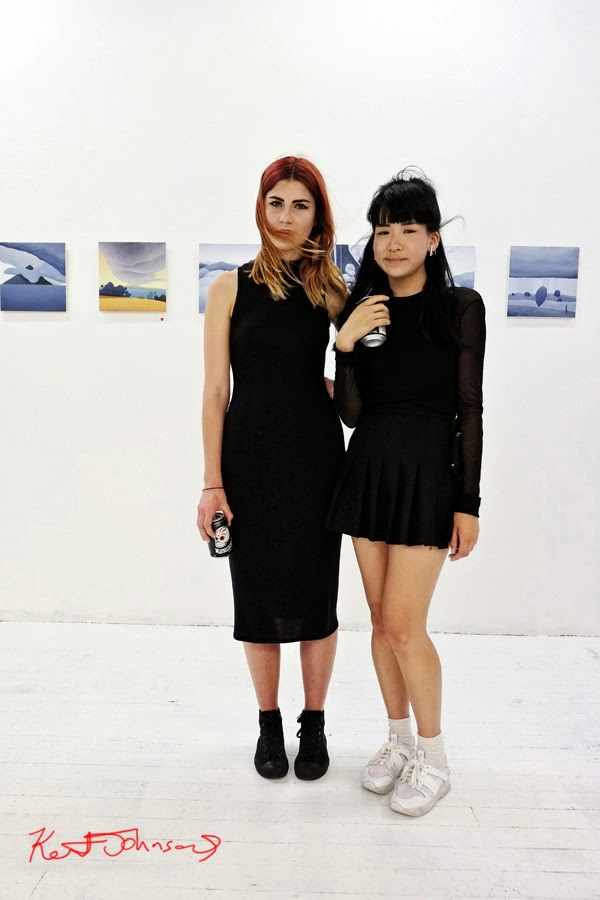 Two beautiful young women dressed in black, summer fashion at China Heights gallery - Photography by Kent Johnson.