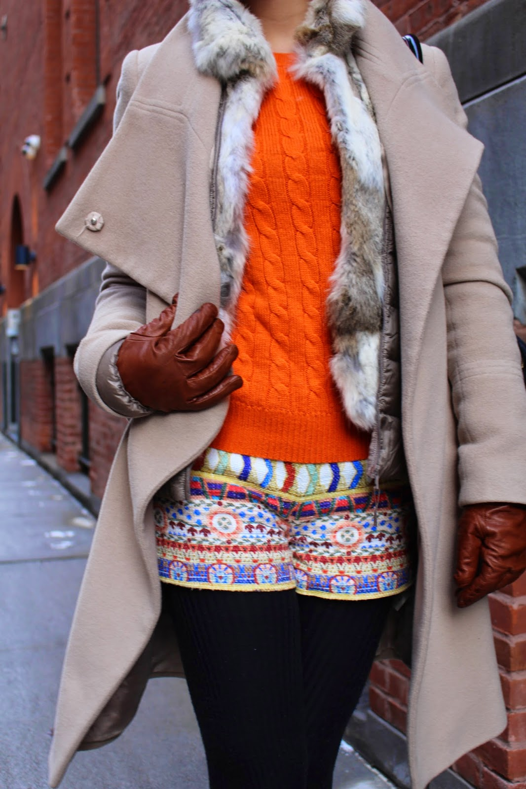 orange sweater + fur vest + tribal shorts = perfect combo