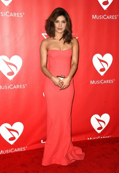 Sexy Priyanka Chopra looking hot in Pinkish Red Dress at MusiCares event