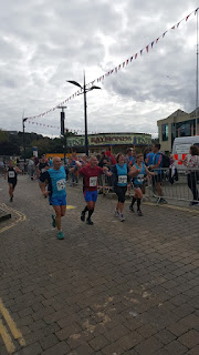 Happy runners finishing the Truro Half Marathon 2015