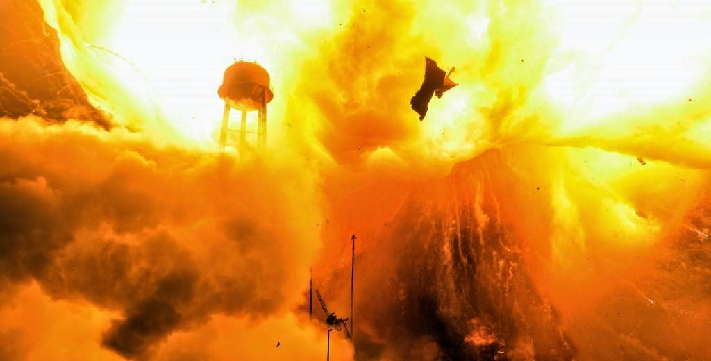 Antares descended into a hellish inferno after the first stage propulsion system at the base of Orbital Sciences' Antares rocket exploded moments after blastoff from NASA's Wallops Flight Facility, VA, on Oct. 28, 2014, at 6:22 p.m. Credit: Elliot Severn/Zero-G News