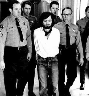 Charles Manson being led away in handcuffs after being found guilty of murder in 1971. Image: Alamy Stock Photo