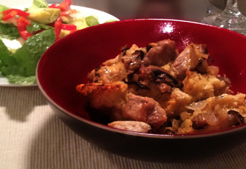 Serving bowl with Savory Bread Pudding and salad - comfort food for the Fall