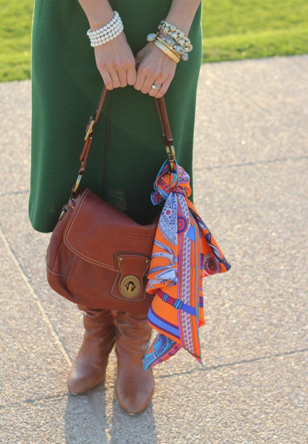 green wool dress, hermes orange scarf, coach legacy ali bag, cognac boots, cindy adams lion earrings