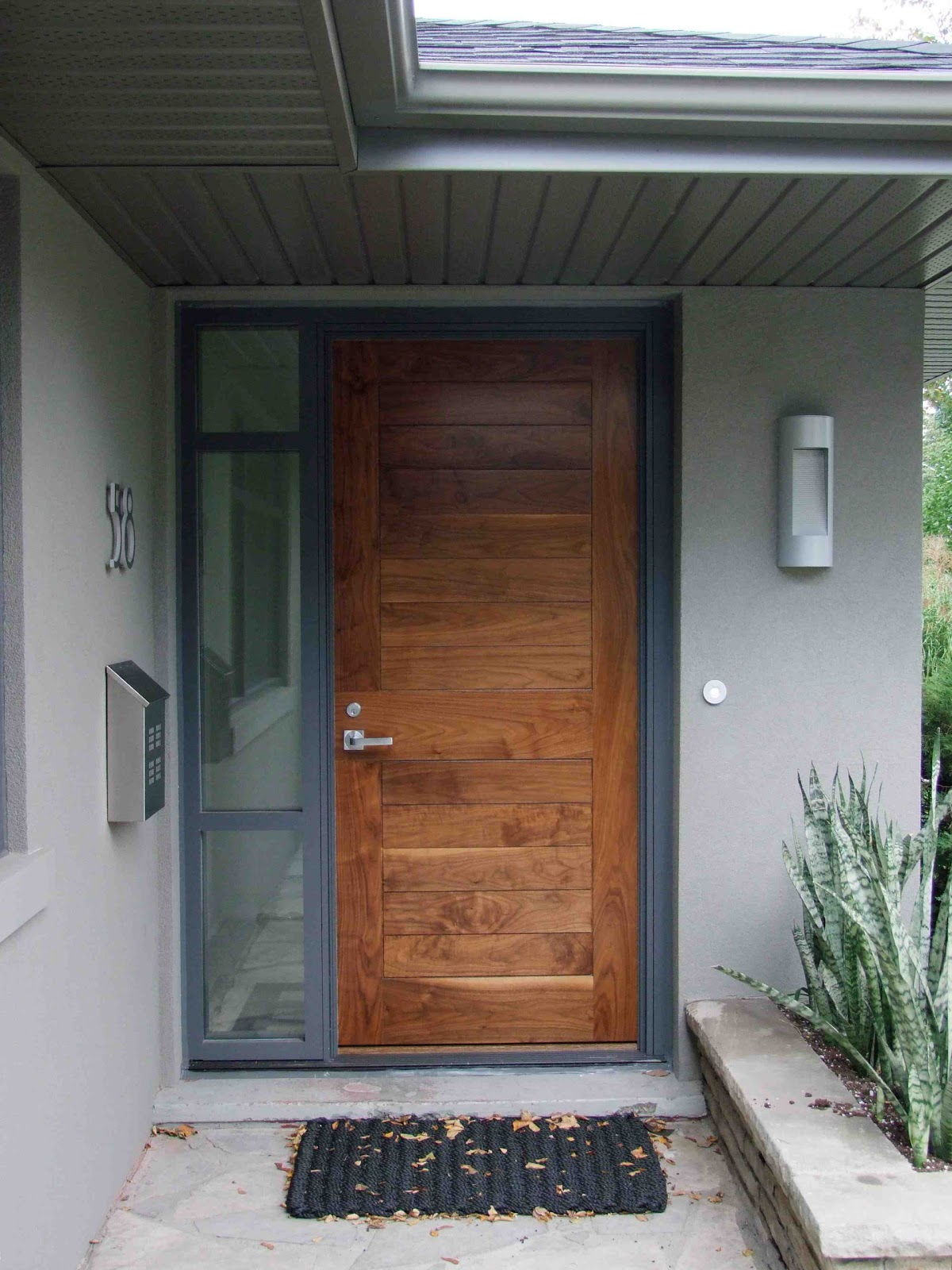 Creed 70 39 s bungalow makes a modern impression for Exterior front entry wood doors with glass