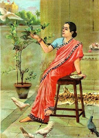 An Indian woman sitting, waring saree